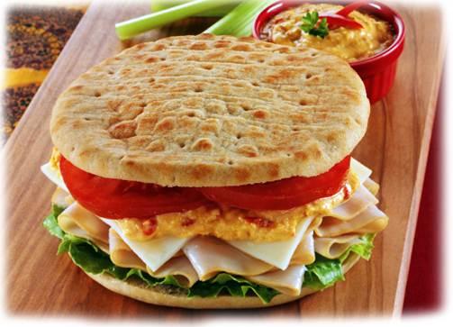 Description: Build sandwich with lettuce, turkey, cheese, hummus