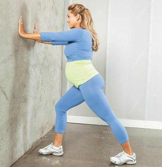 Push wall and extend calf