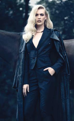 Description: Coat, jacket, trousers, boots, all Salvatore Ferragamo; 'Nice' necklace, Swarovski