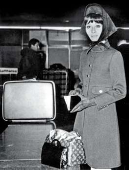 Description: Audrey Hepburn with her Speedy 25