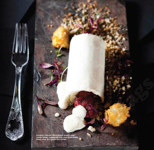 Description: Ostrich Tartare With Roast Garlic And Caper Foam, Parmesan Soil And Deep-Fried Quail Egg In A Rock Salt Dome