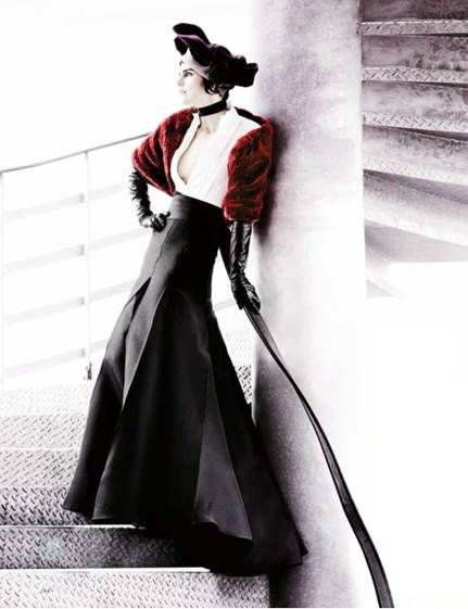 Description: Donna Karan's new formula of a white dinner shirt and sweeping evening skirt speaks of stately matters
