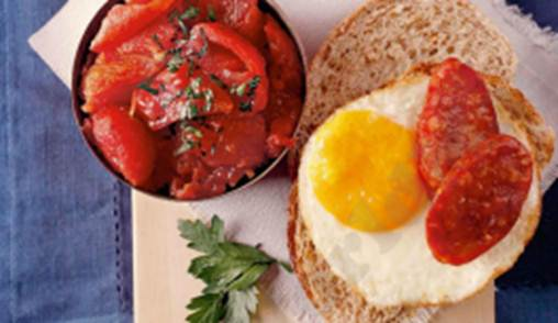 Description: Stewed Tomatoes with Egg and Chorizo on Crusty Bread