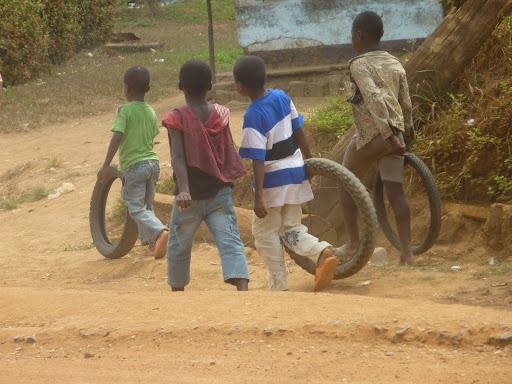 Description: kids rolling tyres