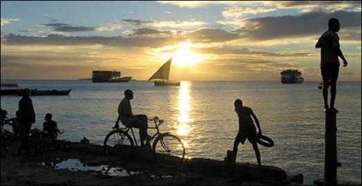 Description: The scene at sunset along the harbor at Stone TOwn in Zanzibar, off Tanzania's coast.