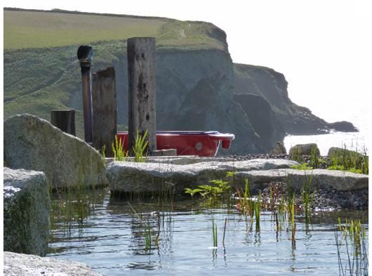 Description: Clifftop hot-tub at The Scarlet