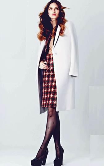 Description: Orange, cream and black tweed skirt