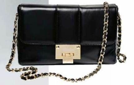 Description: Black chain-strap bag, $293, Russell & Bromley.