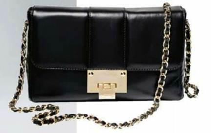 Description: Black chain-strap bag, $293, Russell & Bromley.