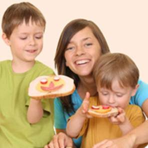 Description: Children eat well by their mothers' tips.