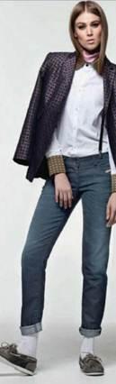 Description: Polyester-mix jacket (worn throughout), and cotton-mix shirt, Denim jeans, Leather shoes, Silver earrings (worn throughout), cravat, braces, Cotton socks