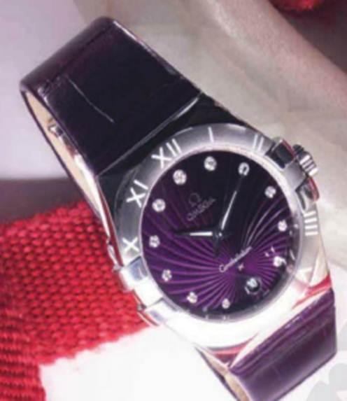 Description: 'Omega Constellation' steel, diamond and alligator-skin watch, $4,050