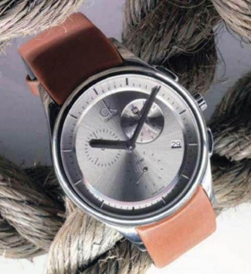 Description: 'CK Basic' steel and leather watch, $405
