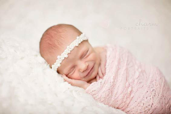 That newborns can dream and spend most of time sleeping in order to develop their brains through dreams is very possible.