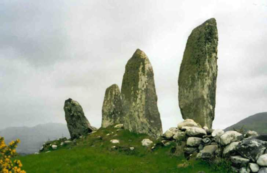 Description: On the top of the hill above the chapel was an alignment of four massive standing stones