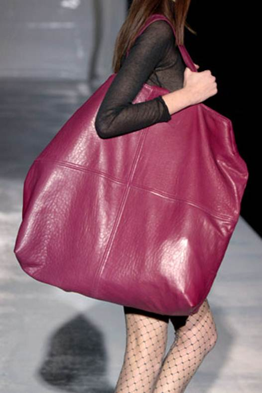 Description: 19 Percent of women who use a big purse as something  to hide behind when they're feeling fat