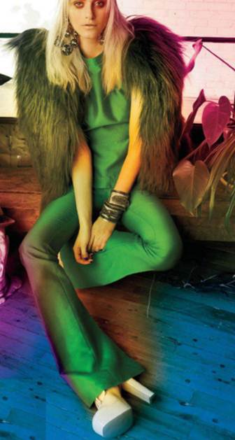 Description: Sleeveless silk top, pants and fur vest; Crystal drop earnings and metal and crystal cuffs and patent-leather platforms