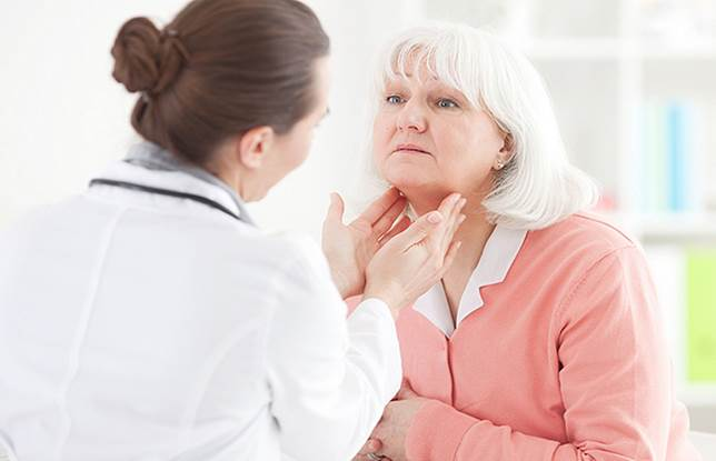 Description: A doctor is checking a patient afftected Autoimmune thyroid