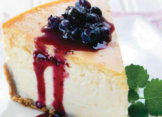Description: Wildflower Honey Cheesecake with Blueberry Compote