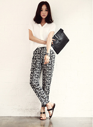 Elegant white shirt combined with black-with patterned pants, which is suitable for stylish girls.