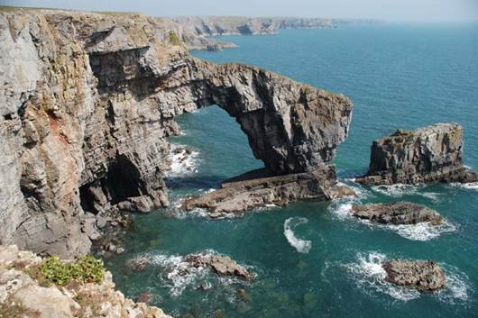 The Green Bridge of Wales is a spectacular natural arch, which has been carved by the sea into the cliffs of the Pembrokeshire coast