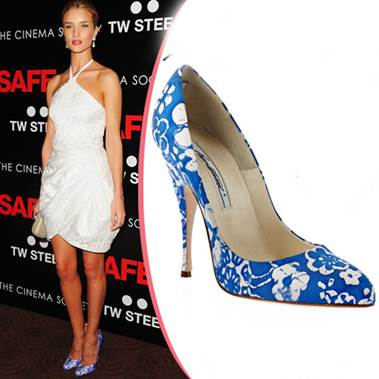 Blue flower shoes of Rosie Huntington-Whiteley are extremely prominent on background as white dress.