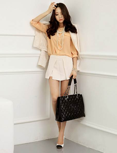 An elegant combination with blazer and shorts