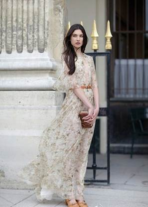 The girl is in maxi with flower pattern,floating chiffon material, and feminine pastel tone as if she has  just come out from fairy tales.