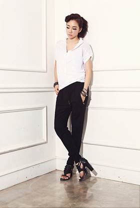 Black pants mix with gentle, simple white shirt.