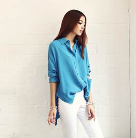 Wide blue shirt is prominent when mixed with white jeans.