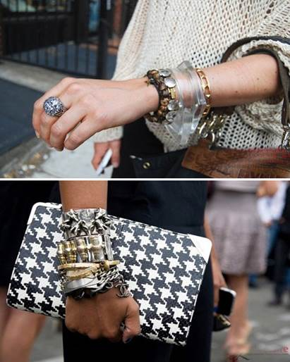 A stylish purse and layer bracelet on hands create fantastic fashion style.