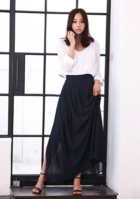 Wide shirt mixes with graceful maxi skirt.