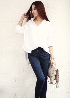White active office shirt combines with tight jeans.