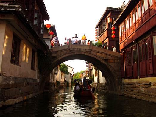 Tourists enjoying a boat tour through Zhouzhuang's ancient canals